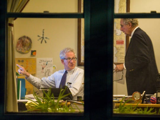 Mediator Ira Lobel, left, confers with Burlington School District Attorney Joe McNeil as mediated negotiations between the Burlington School Board and the Burlington Education Association, the teachers union, continue into the evening in Burlington on Tuesday, September 19, 2017. The teachers have been striking for four days.