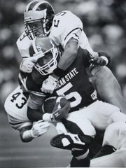 MSU receiver Courtney Hawkins is tackled after a first