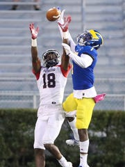Delaware's Malcolm Brown defends a pass meant for Richmond's Dejon Brissett in the fourth quarter of Delaware's 42-35, double overtime win at Delaware Stadium last year.