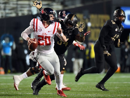 Mississippi Rebels quarterback Shea Patterson (20) scrambles while chased by Vanderbilt Commodores defensive end Dare Odeyingbo (34) during the first half at Vanderbilt Stadium. Mandatory Credit: Christopher Hanewinckel-USA TODAY Sports