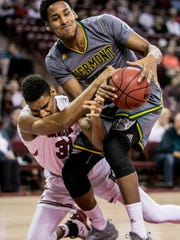 South Carolina Gamecocks forward Jarrell Holliman (31) and Vermont Catamounts forward Darren Payen (12) battle for the loose ball in the second half at Colonial Life Arena.