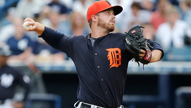 Tigers pitcher Buck Farmer  pitches during the first inning of a spring training baseball game against the New York Yankees at George M. Steinbrenner Field on Monday.