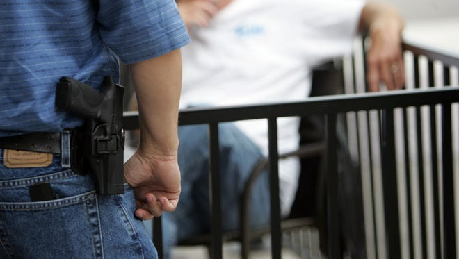 Michigan law allows the holder of a concealed pistol license to openly carry a firearm in and around a public school, but not to carry a concealed weapon there.