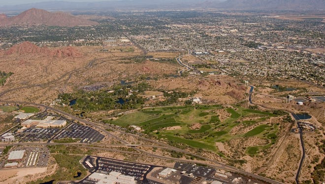 An aerial view of Rolling Hills Golf Course and nearby Papago Park in Phoenix.