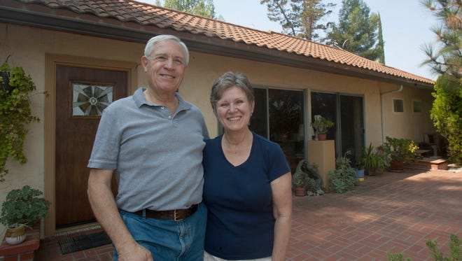 Jon (left) and Linda Lambert stand in front of their home on Taormina Lane in Ojai.