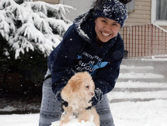 Litzy Dorantes, 14, of Vineland, plays with her dog