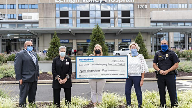 Dorney Park & Wildwater Kingdom present check for $15,000 to Lehigh Valley Health Network. Pictured from left are: Lou Puentes, vice president of Operations and Public Safety, Lehigh Valley Health Network; Terry Burger, registered nurse, administrator of Infection Control and Prevention, LVHN; Tana Korpics, manager of Public Relations and Communications, Dorney Park; Jane Wrisley, vice president of Philanthropy, LVHN; Officer Luis Perez, chief of patrol, Dorney Park.