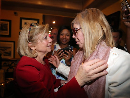 Shelley Mayer, left, is congratulated by supporter