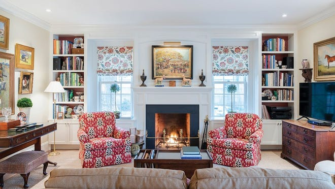 Informal entertaining takes place in the keeping room at the rear of the house. Built-ins contribute period character and deep window sills ideal for display.