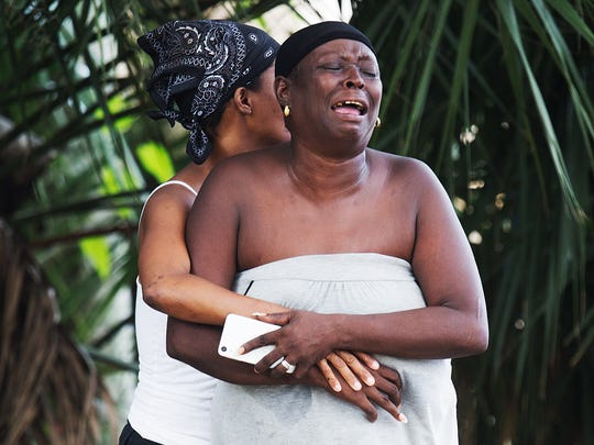 "A family member of a homicide victim at an apartment complex on Seminole Ave. in Fort Myers reacts at the scene on Wednesday.  She said ""They won't let me see him.""  It was an emotionally charged scene with family and friends rushing to site."