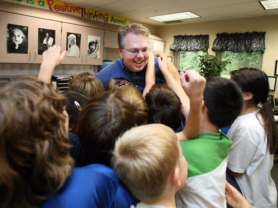 Jay Vahle, the runner-up 2010 Teacher of the Year, gets high fives and hugs from students at Woodbrook Elementary School in Carmel.