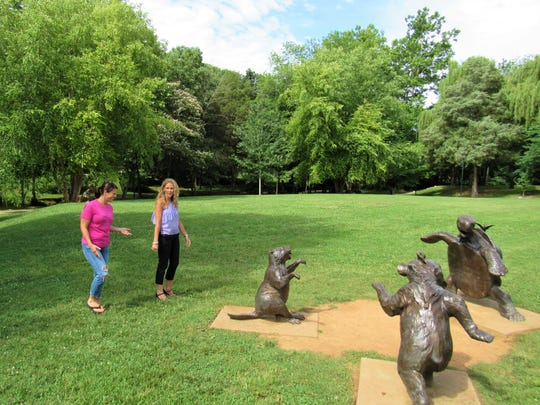Founders Park is a relaxing family park with plenty of open space; bronze sculptures provide inspiration for play. Farragut's own Shandy Dixon and Amy Boling, founders of the Lawn Chair Concert Series, took time to enjoy them.
