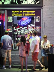 Visitors take a peek inside Tootsie's Orchid Lounge
