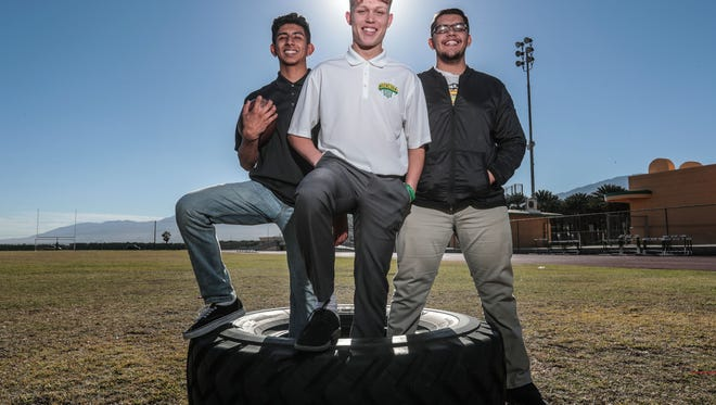 (From the left) Coachella Valley High football players Armando Deniz, Angelo Fitzgerald, and Jose Cuevas on Wednesday, December 13, 2017 in Thermal.