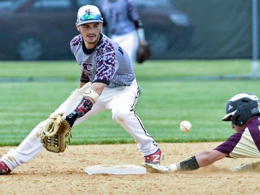 Millersburg's Austin Lehman, right, slides into second base before Tristan Douglas, of Southern Fulton, can make the catch. Millersburg got runners in scoring position just two times, and Southern Fulton won 10-0 in five innings.