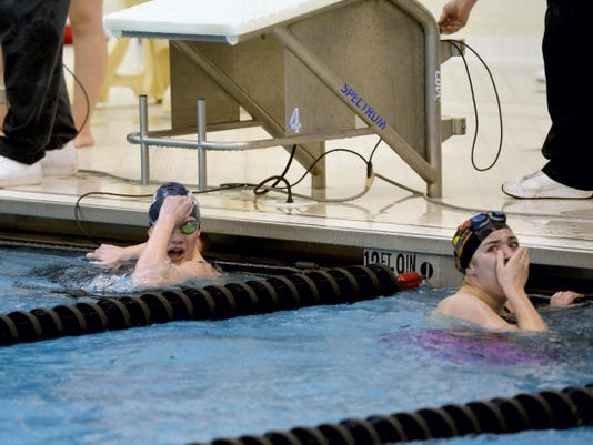 West York's Taylor Hoover, left, and Dover's Lindsay Brenneman react to their finish times after the 200-yard freestyle during the YAIAA swimming championships Thursday at Central York. Hoover won the race in 1:56.54, the first time she broke 2 minutes in the event since her freshman year. It was also a career best for the junior, who credited silver medalist Brenneman for pushing her to the 1.12-second victory. 'Having her next to me was the reason for that time,' Hoover said.