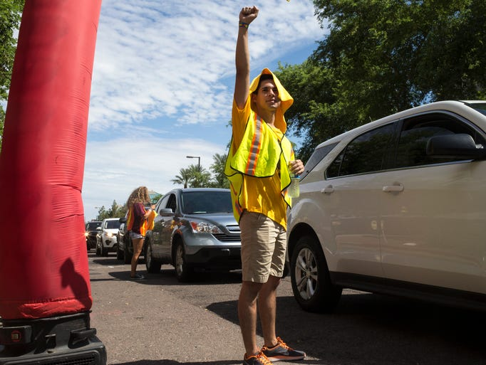 Jason Ortiz of Sparky's Welcome Team directs traffic