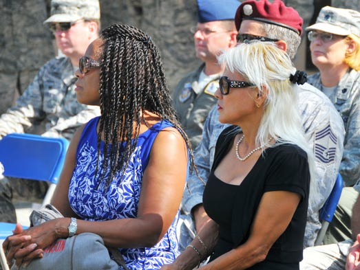Airmen at Patrick Air Force Base gathered on Wednesday, June 25, 2014 to remember the 1996 bombing at Khobar Towers in Saudi Arabia. Shyrl Johnson and Jenny Haun, seen here, lost their husbands in the attack: Staff Sgt. Kevin Johnson and Capt. Leland Haun.