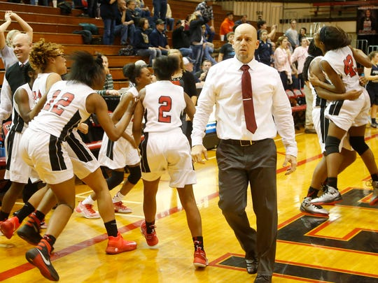 The Lafayette Jeff bench erupts behind head coach Andy Baker after the Bronchos rallied to defeat Fountain Central 58-57 Wednesday, January 11, 2017, in Lafayette. It was Jeff's 11th win in a row.