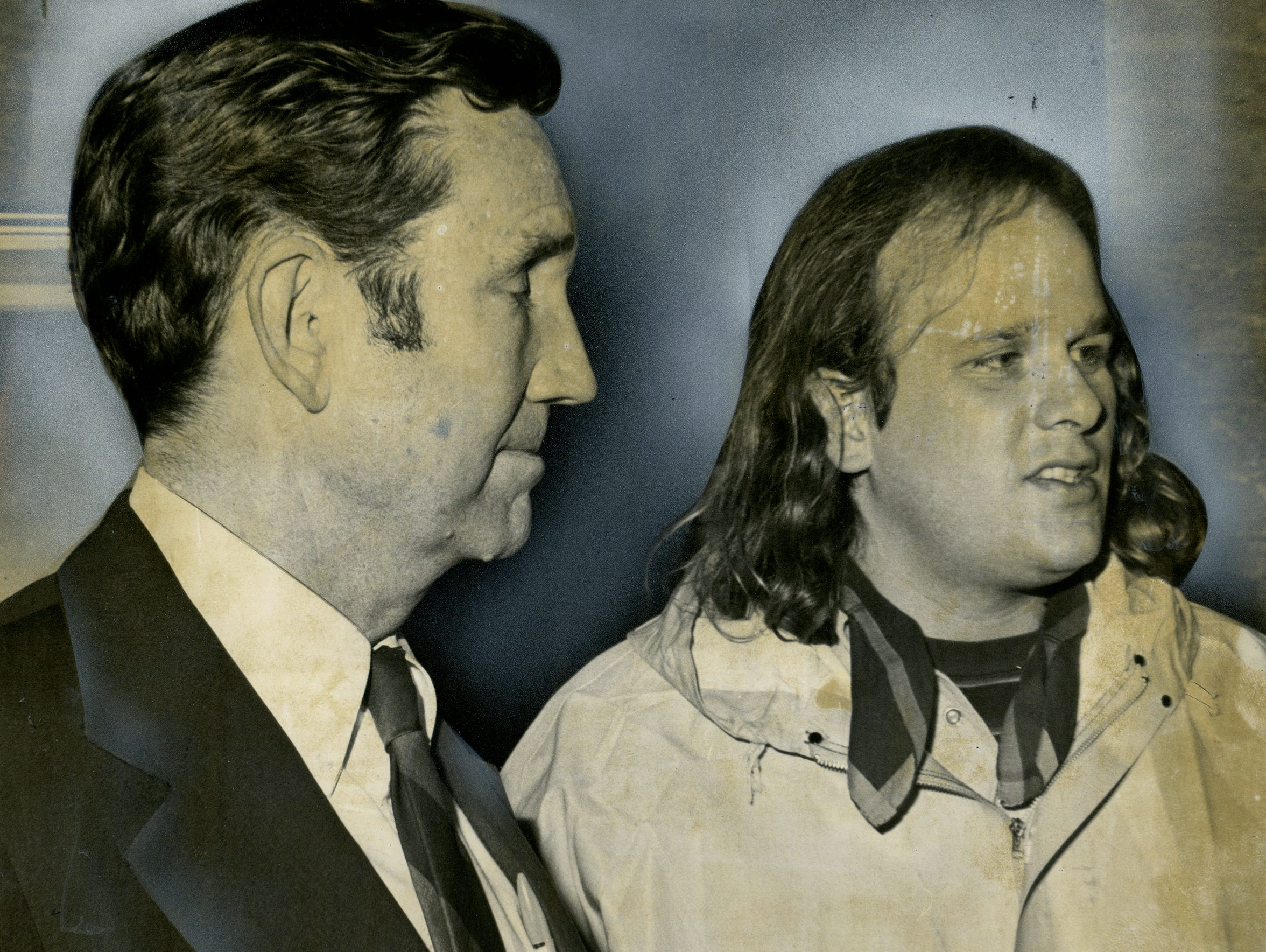 Former attorney general Ramsey Clark, left, accompanies