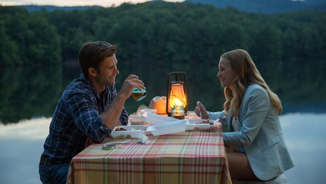 """This photo provided by Twentieth Century Fox shows, Scott Eastwood as Luke, and Britt Robertson, as Sophia, in a scene from the film, """"The Longest Ride,"""" directed by George Tillman, Jr. The movie releases in the U.S. on April 10, 2015. (AP Photo/Twentieth Century Fox, Michael Tackett)"""