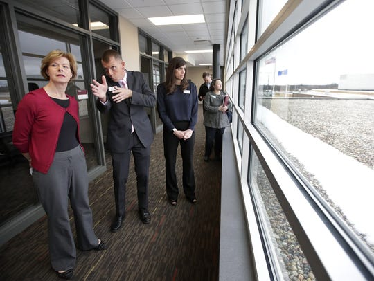 U.S. Sen. Tammy Baldwin is given a tour of Fox Valley Technical College's Public Safety Training Center by Jeremy Hansen, associate dean of public safety and director of the training center, before making an announcement at the college about the America's College Promise Act of 2018 Friday in Greenville.
