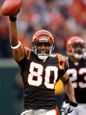 Cincinnati Bengals wide receiver Peter Warrick celebrates as he runs in a punt return for a touchdown against the Kansas City Chiefs in 2003.