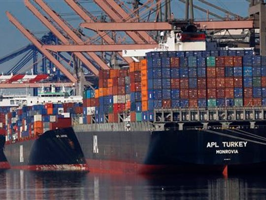 In this Feb. 23, 2015 file photo, container ships wait