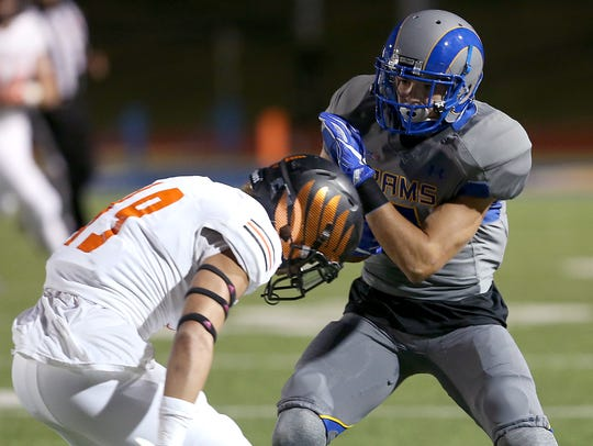Angelo State's Lawson Ayo is shown against the University