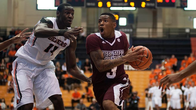Dec 13, 2014; Corvallis, OR, USA; Mississippi State Bulldogs guard Trivante Bloodman (3) drives to the basket while being defended by Oregon State Beavers forward Daniel Gomis (14) during the first half of the game at Gill Coliseum. Mandatory Credit: Godofredo Vasquez-USA TODAY Sports