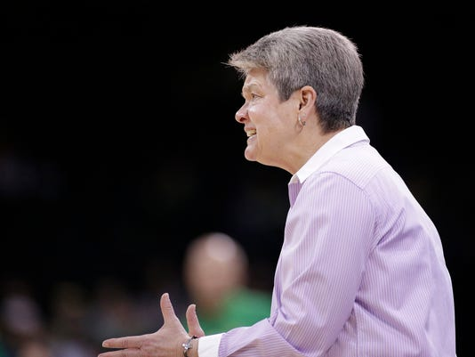 Central Michigan head coach Sue Guevara speaks to her team during the first half in a regional semifinal at the NCAA women's college basketball tournament against Oregon, Saturday, March 24, 2018, Spokane, Wash. (AP Photo/Young Kwak)