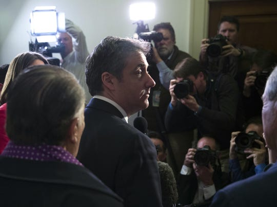 Michael Cohen, President Donald Trump's former lawyer, departs after speaking with the media after testifying before the House Oversight and Reform Committee, accompanied by his lawyers, Michael Monico, left, of Chicago and Lanny Davis of Washington, on Capitol Hill, Wednesday, Feb. 27, 2019, in Washington.
