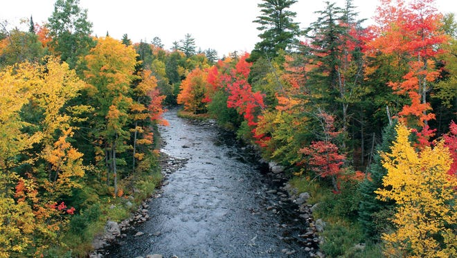 The Dead River in Big Bay, Mich., with fall foliage turning shades of yellow, orange and crimson, signaling the arrival of fall. Picture taken September 2015.