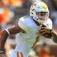 Jalen Hurd carries the ball in the Orange and White game