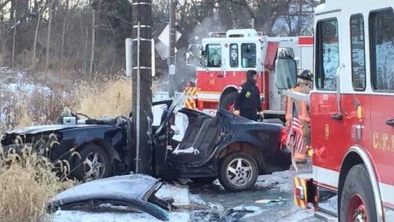 A woman had to be extricated from her car after it slid on black ice and crashed into a pole Monday morning on Clifton Ave.