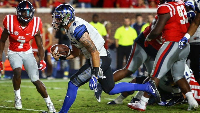 October 1, 2016 - University of Memphis quarterback Riley Ferguson scrambles past the Ole Miss defense for his second touchdown against the Ole Miss defense during fourth quarter action at Vaught Hemingway Stadium in Oxford, Miss.
