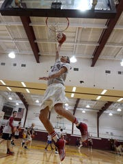 Madison sophomore center Andy Christos goes up for