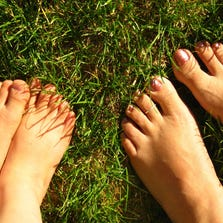 Walking barefeet in the grass is a healthy form of grounding, according to the website, MindBodyGreen.com.