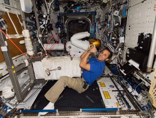 NASA astronaut Joe Acaba posed for a photo with Robonaut