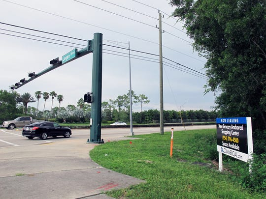 The Landings at Logan retail center is proposed for 18 acres of densely forested property on the southeast corner of Immokalee Road and Logan Boulevard in North Naples.