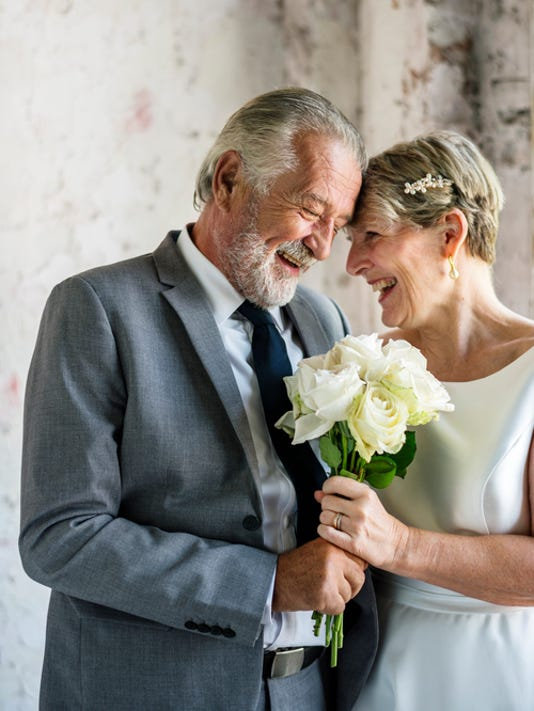 Senior Couple with White Roses Flower Bouqet