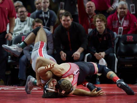 Rutgers 149-pounder Eleazar DeLuca throws Ohio State's