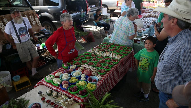 Norma Gilman and her husband Donald sell fresh produce at the grand opening of the Concho Valley Farmers Market in 2016. The thrice-weekly sales kick off Saturday at the Farmers Market Pavilion.