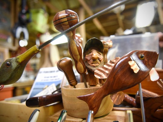 Several items made of wood by Ray Tuholsky are on display