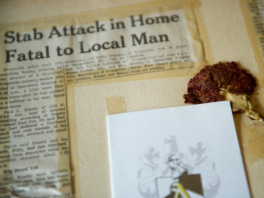 Vicky Burnett, of Evansville, keeps newspaper clippings and other items related to her father's murder, Friday, Sept. 7, 2016. Burnett's father, Paul Roedel was murdered on July 5, 1971, the case remains unsolved.