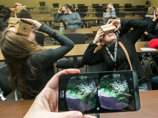 APECHS students visit a rain forest on Tuesday using Google Cardboard virtual reality headsets. APECHS was participating in the Google Expeditions Pioneer program.