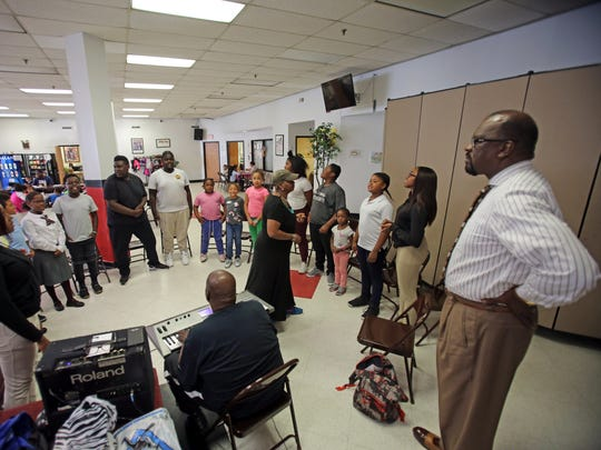 Jim Bostic, executive director, right, listens to students during choir practice in the after school program at The Nepperhan Community Center in Yonkers Oct. 2, 2017.
