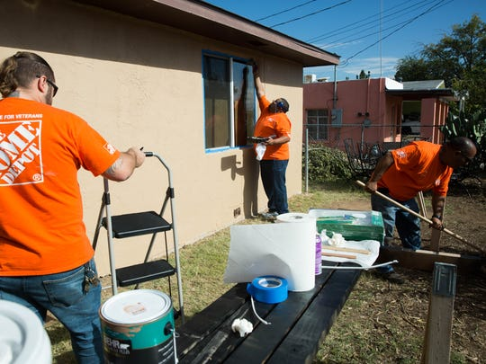 A group of volunteers from Home Depot works to renovate Francis Madrid's Las CRuces as part of a program to help veterans and their families in the community. Thursday November 9, 2017.
