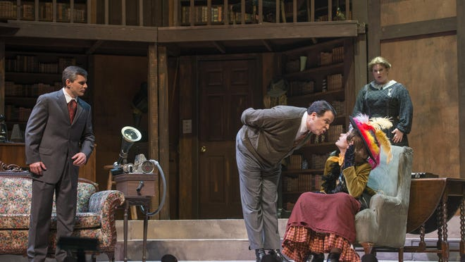 Eliza Doolittle (portrayed by Michaela Jacobs), center, and Professor Henry Higgins (portrayed by Mario Cieri), second from right, rehearse My Fair Lady at the Pensacola Little Theatre on Wednesday, March 1, 2017.
