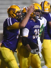 C.E. Byrd's Bailey Obyrne is congratulated after scoring